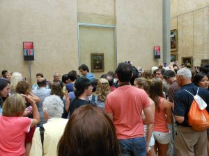 "The tourists crowds amass around ""The Mona Lisa"""