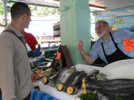 Take a moment to chat with the fishmonger and learn about the big, scary-looking river fish he's selling today. It's honestly fascinating!