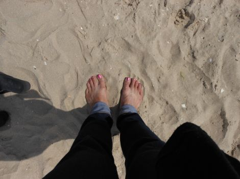 Utah Beach, Normandy (D-day).  Going barefoot on the sand gave me a chance to physically and emotionally connect with this historic place.
