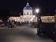 Love and lust on the Pont des Arts against the backdrop of L'Institut Français (L'Académie Française).