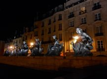 Bronze sculptures serve at nighttime sentinels near the Musée d'Orsay.