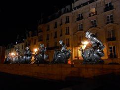 Bronze sculptures serve at nighttime sentinels near the Musée d'Orsay.