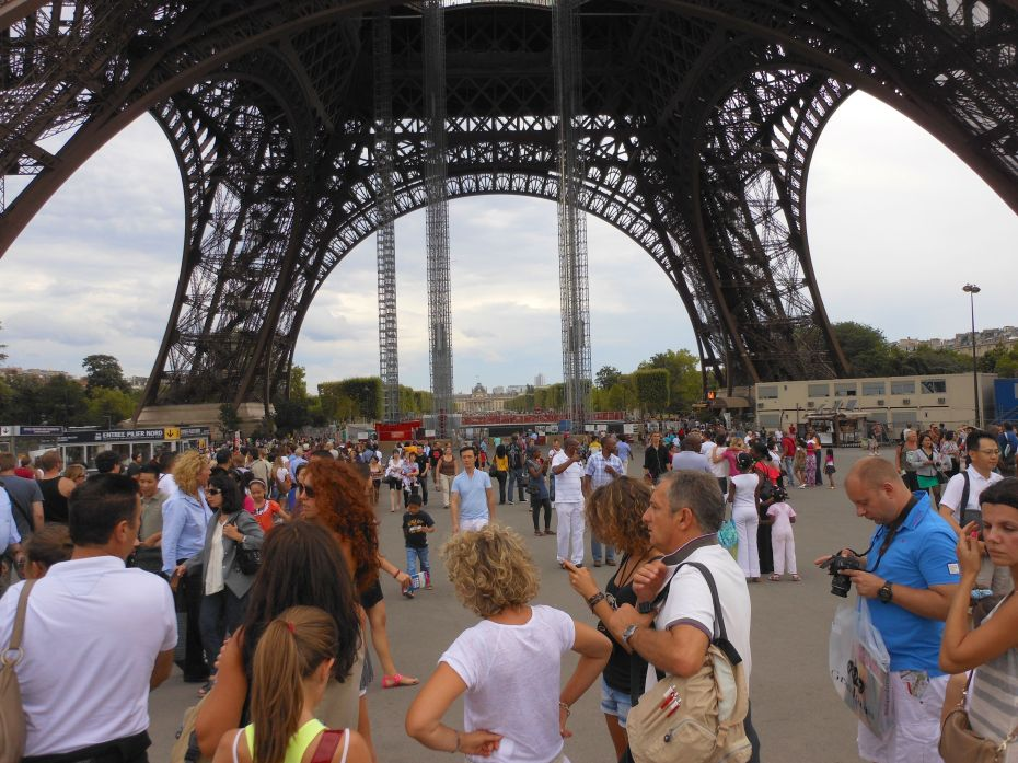 People were waiting for two hours just to buy their tickets so they could stand in line again to take the elevator up the Eiffel Tower.