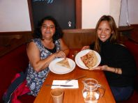 Cristina Duarte and I enjoy a midnight crêpe in Paris.