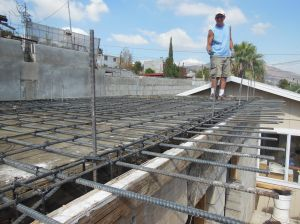 We joined our group leader, Cliff, on the roof to help tie down the rebar checkerboard he laid out.