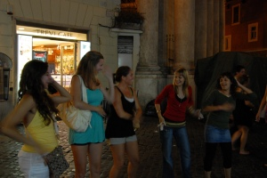 My students let their guard down and dance with local teens near the Trevi Fountain.