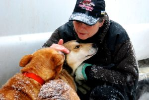 """""""Lovin' on"""" her dogs, Jan helps keep them (and herself) calm and focused."""