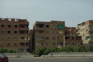 Endless rows of tenements like these stretch on for miles from Cairo to its distant suburbs.
