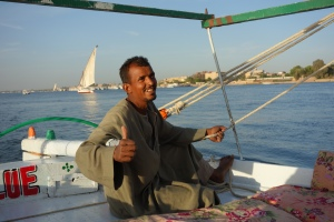 Our captain Mahmoud, a third generation felucca owner, proudly takes us on his sailboat to explore the beauty of the Nile.