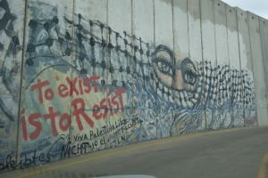Graffiti on a segment of the massive wall that divides Israel and the West Bank.