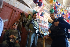 Armed Israeli soldiers decide who can enter the section of Jerusalem that shelters the Dome of the Rock-- the Muslim shrine which houses the rock from which the prophet Muhammed ascended to heaven.