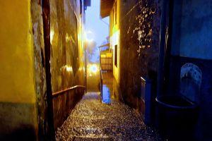 Rivers of rain rush downhill in Varenna towards the Lago di Como.