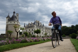 "Biking his way through Catherine de Medici's garden at Chenonceau, Rick nails the ""teaser""."