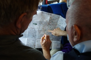 Rick and Richard consult the city map to make sure everything is kosher for the RS Northern European Cruise Ports guidebook.