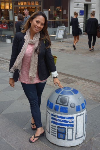 I love clever. Instead of leaving this car-blocking cement stump plain, it gets an R2-D2 makeover and welcomes the townsfolk into the pedestrian zone.