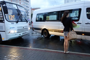 A young Russian lady waits for the local bus.