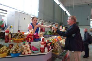 Rick samples homemade pickles at a St. Petersburg market hall.