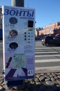 Umbrellas for sale from a vending machine...genius.