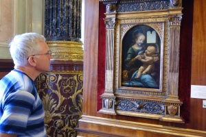 A man admires a Da Vinci (one of two) on display at the Hermitage.