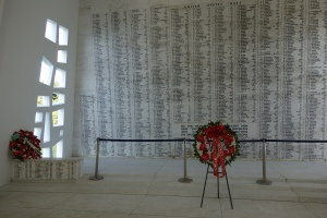 1,177 names of sailors of the Arizona who perished on December 7, 1941 and carved in stone and are flanked by two sets of Tree of Life windows.