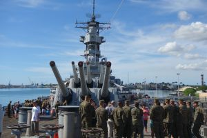 Marines visit the USS Missouri as tourists.