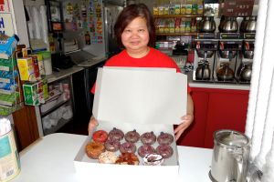 Nancy proudly packs our donut selections.