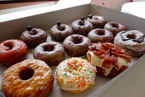 4 ube glazed, 4 ube with blueberry glaze, 1 glazed cronut, 1 nutella cronut, 1 Canadian Favorite, and a complimentary rainbow sprinkles cake donut.  Thanks, Friendly Donuts!