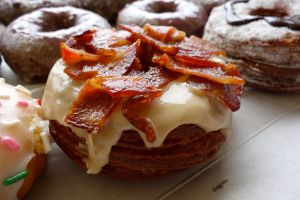 Heaven comes in the shape of a cronut and is covered in maple glaze and crispy bacon.
