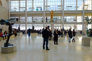 Rick admires the sculptures in the Met's Charles Engelhard Court.