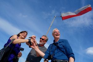 Terri, Reid, and Dave celebrate their successful climb to Ehrenburg Castle with an ice cold Stella.