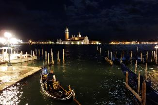 Few gondolieri brave the high water tonight in Venice.