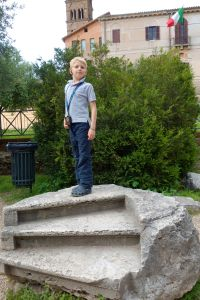Our youngest tour member, Brogan, stands proud as a Roman statue in the Forum.