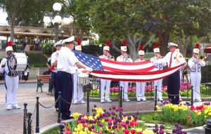 Every evening before sunset, a flag-lowering ceremony stirs the patriotic hearts of Disneyland visitors.