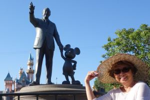 "The ""Partners"" statue--Walt Disney and Mickey Mouse--in Disneyland's Hub (in front of Sleeping Beauty Castle) and my mom, who is always young at heart at Disneyland."