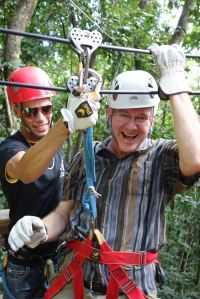 Rick is an old pro at ziplining and is all smiles.