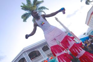 A Moko-Jumbi stilt-walker dances and parades his way through the streets of Basseterre.