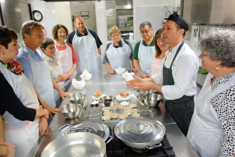 Francesco teaches his group the proper way to make fresh pasta.