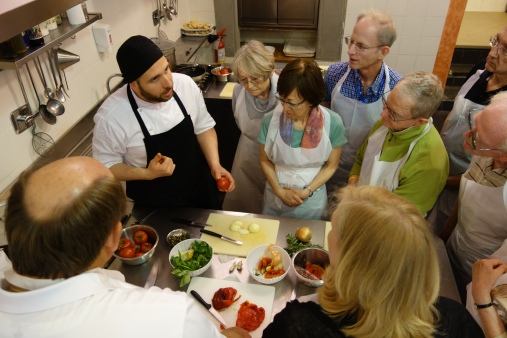 Walter instructs his group on the fine points of tomatoes.