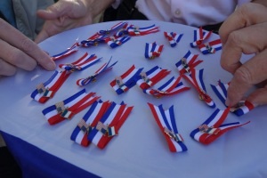 Tours members on one of Paris and the Heart of France tours receive France-USA pins as gifts to remember the memorable connections they made with the French culture and people.
