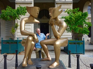 "Enamored with this sculpture, Rick tries to talk to the subjects of this piece called ""The Conversation""."