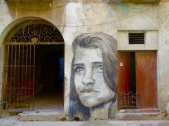 Street art invades old walls of crumbling facades.