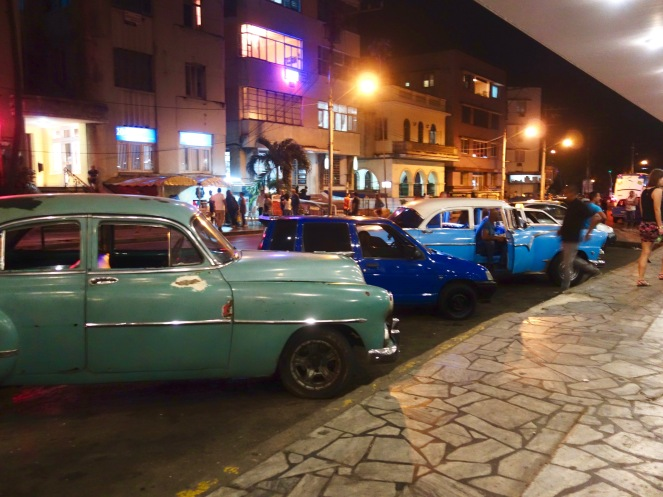 Like a scene from American Graffitti, classic cars line the streets of Havana.