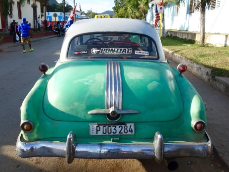A proud Pontiac makes its way through the streets of Viñales.