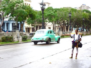 "After ballet class, this young Cuban hails an inexpensive ""taxi particular"". Just stick out your hand and an available car will eventually stop."